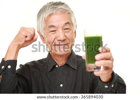 senior Japanese man with green vegetable juice - stock photo