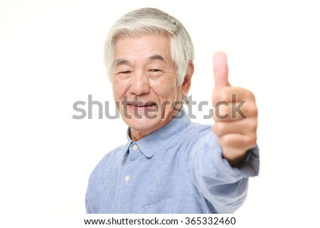 senior Japanese man with thumbs up gesture - stock photo