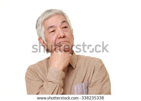 senior Japanese man worries  - stock photo