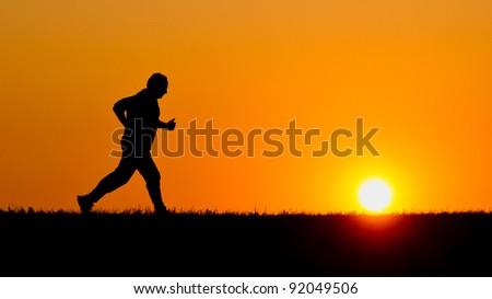 senior jogging in sunrise - stock photo