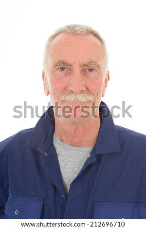 Senior laborer in blue work wear isolated over white background - stock photo