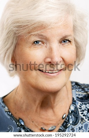 Senior lady looking relaxed at camera - stock photo