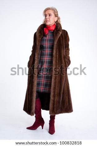 Senior lady wearing a mink coat - stock photo