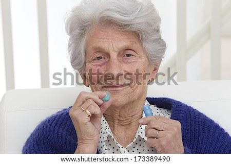 Senior Lady with homeopathic medicine