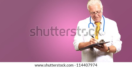 Senior Male Doctor Writing On Clipboard Isolated On Pink Background - stock photo