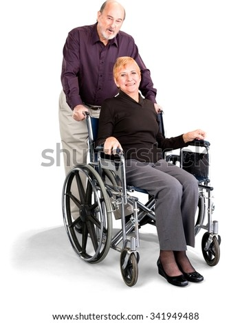 Senior Male & Female Couple in casual outfit with happy elderly woman in wheelchair - Isolated - stock photo