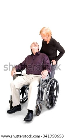Senior Male & Female Couple with man in wheelchair in casual outfit looking at each other - Isolated