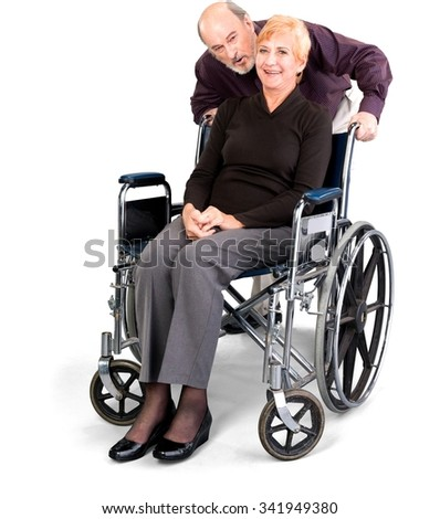 Senior Male & Female Couple with woman in wheelchair in casual outfit - Isolated