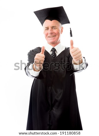 Senior male graduate making thumbs up gesture with both hands