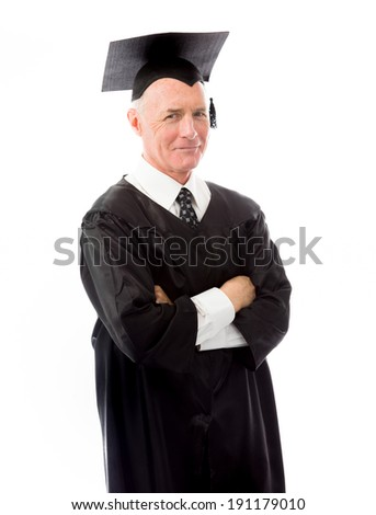 Senior male graduate standing with arms crossed