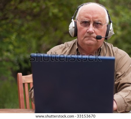 senior male on laptop, place advert on laptop
