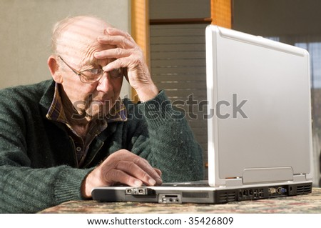 Senior man and laptop looking stressed