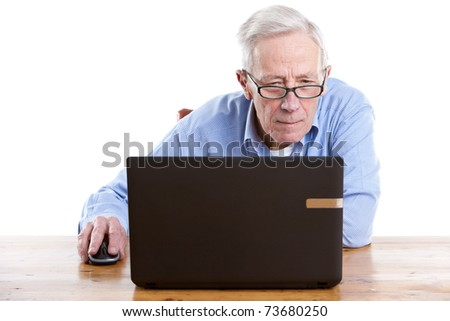 Senior man behind his computer looking interested on white background