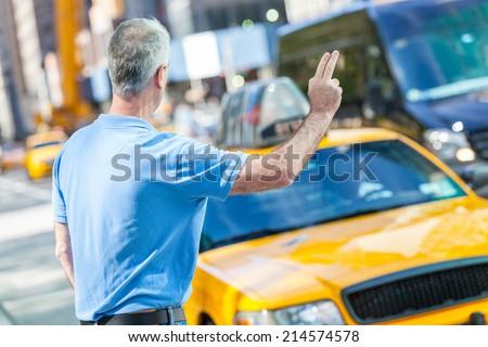 Senior Man Calling a Cab in New York - stock photo