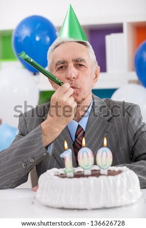 Senior man celebrates 100th birthday - stock photo