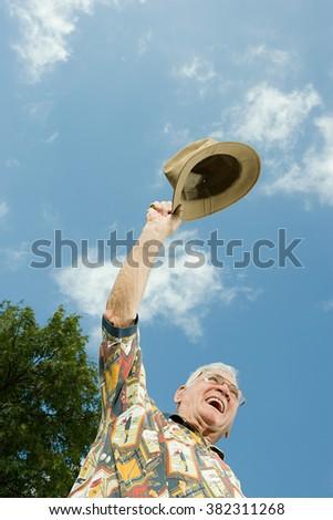 Senior man celebrating - stock photo