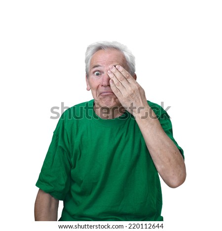 Senior man closed one eye with hand isolated on white background