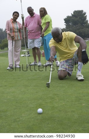 Senior man devising golfing strategy - stock photo