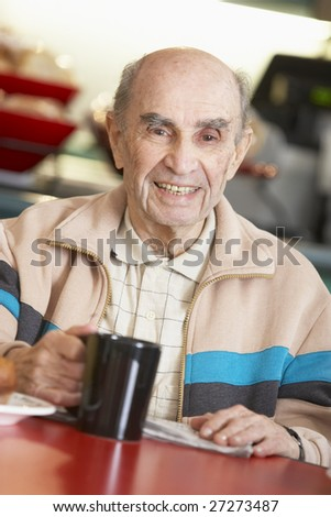Senior man drinking hot beverage - stock photo