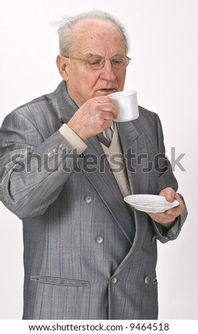 Senior man drinking tea from a cup. - stock photo