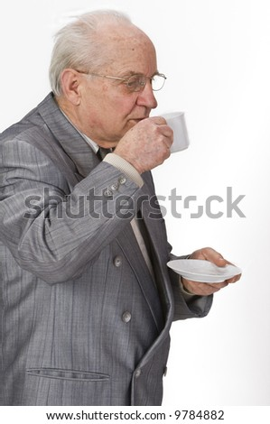 Senior man drinking with pleasure from a coffee cup. - stock photo
