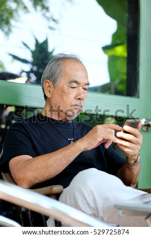 senior man enjoying on his phone
