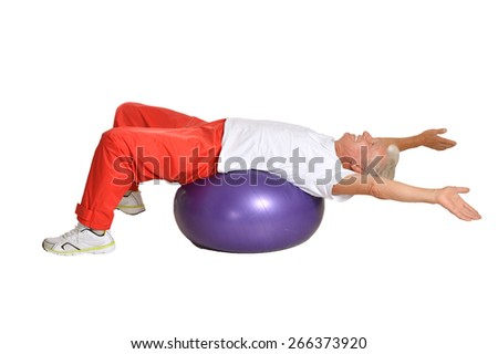 Senior man exercising with ball on white background