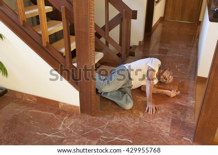 Senior man fell down the stairs - stock photo