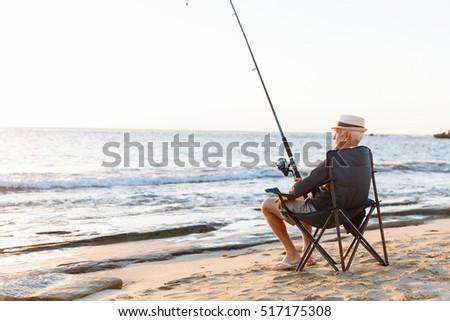 Senior man fishing sea side stock photo 481269964 for Senior fishing license