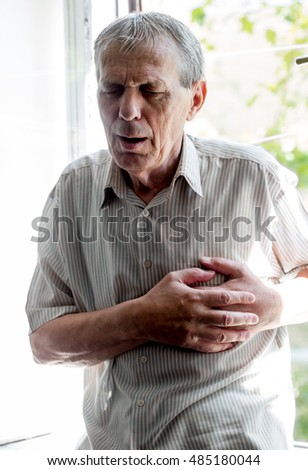 Senior man  having a heart attack