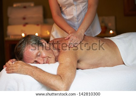 Senior Man Having Massage In Spa - stock photo