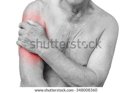 Senior man having shoulder pain,monochrome photo with red as a symbol for the hardening - stock photo