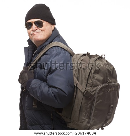 Senior Man Hiking with Backpack with smirk on face.