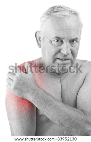 Senior man holding his shoulder, having ache - stock photo