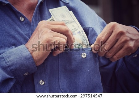 Senior man holding of dollars