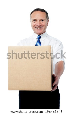 Senior man holding packed cardboard box - stock photo