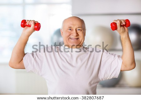Senior man  holding weights