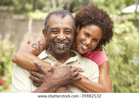 Senior Man Hugging Adult Daughter - stock photo