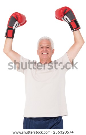 Senior man in boxing gloves on white background