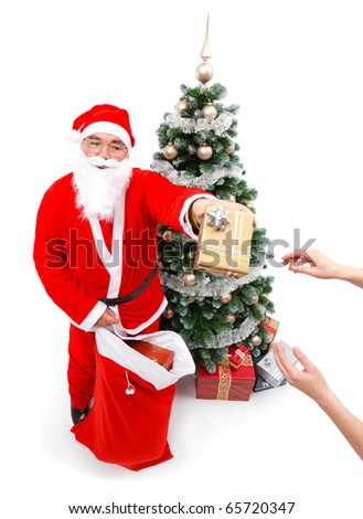 Senior man in Santa Claus uniform, giving a gift from bag to somebody