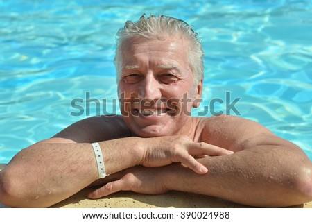 Senior Man in Swimming Pool - stock photo