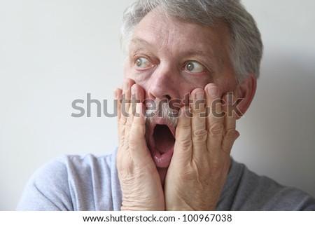 senior man is frightened - stock photo