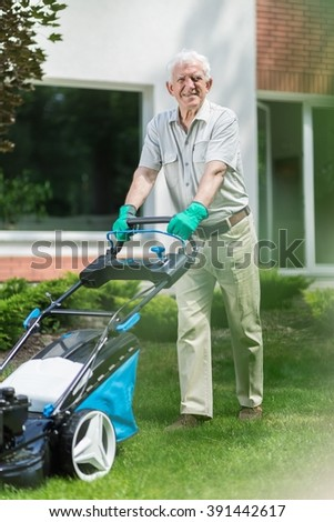 Senior man is going outside to mown his lawn