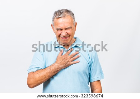 Senior man is having pain in his chest.Heart attack symptoms - stock photo