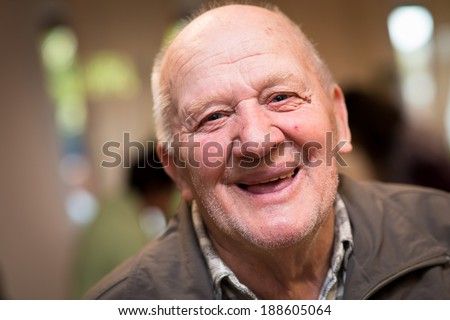 Senior man looking directly at the camera and smiling - stock photo