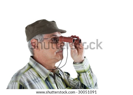 Senior man looking far away via binoculars
