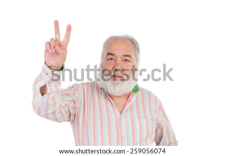 Senior man making the gesture of victory isolated on a white background - stock photo