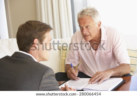 Senior Man Meeting With Financial Advisor At Home