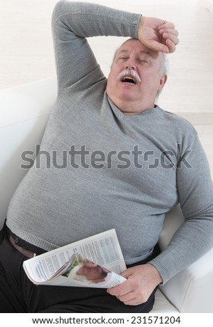 senior man obese having a nap - stock photo