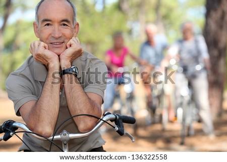 Senior man on a bike - stock photo
